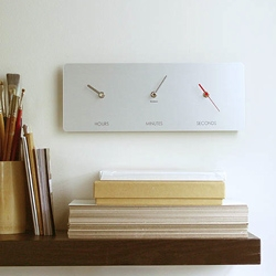 """Just a moment"" clock by FLUKE. Hours, Minutes, and Seconds each have their own hand and their own space..."