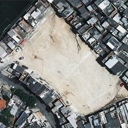 Great images from photographer Joachim Shmid show how unused space in Brazil is turned into football fields - regardless of shape!