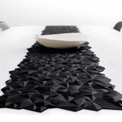 FINELL's Join silicone placemats work three ways: They can be used as individual mats, aligned to create table runners, and work great as heat-resistant trivets. Shown here in black Facet.