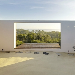 The sandbox at The Southern House leads to a wood deck that overlooks Australia's coastline.