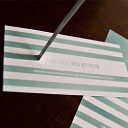 You have to pull the stripe off to see contact details on this business card.