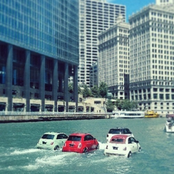 Onlookers along the Chicago River couldn't believe their eyes on Sunday afternoon when a fleet of little red, cream, and mint colored Fiats appeared to be driving on the river!