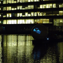 Focus #2, a giant eye moving around on the canals of Amsterdam.