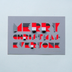 Clever laser cut and hand assembled Christmas card by Oliver Hrubiak embodies the joy of opening advent calendar windows.