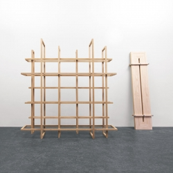 Grid, made up of 12 wooden frames, use as freestanding bookcase or room divider.