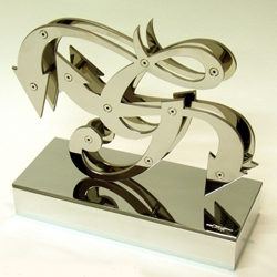 "Graffiti legend MARE 139 was commissioned to make this G-Unit award for rapper 50 Cent. Known for his ""wild style"" sculptures, he used the G-Unit 'G' and polished it off with his trademark ""graff arrows."""