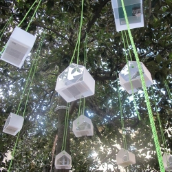 """Livre Echange"" is an autonomous and free bookshop for the city. The installation consists of suspended huts. The inhabitants of districts are invited to deposit a book to take an other one... Design Didier MULLER."