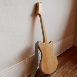 "A gorgeous solid wood ""voice powered"" guitar for kids.  Designed by Danridge Geiger of The Make Believe Company"