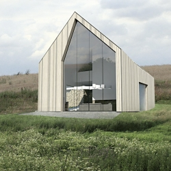 Neostudio's family house in Garby, Poland. The traditional gable roof with asymmetrical openings on two ends, which are proportioned with high and large windows, connecting the interior spaces with the surrounding landscape.