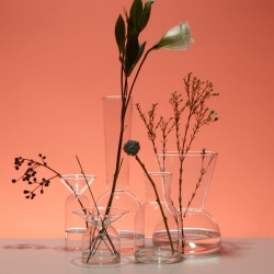 The Gather Vases, designed by Sam Anderson for Good Thing, extend the process of arranging flowers to the vessels they are arranged in. Each vase's unique proportion lends itself to a different kind of blossom or bunch.