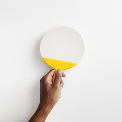 The Utility Mirror, made by polishing a piece of stainless steel to a mirror finish, dipping it in an industrial rubber tool grip, celebrating marriage of industrial methods. By Visibility for Good Thing.