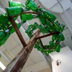 Design studio, Ideas On Legs, created a very cool spiral glass topiary, made out of recycled Grolsch bottles!