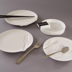 Grooveware is a series of three porcelain dishes and an ashtray. The basic forms are generic, except for the fact that each is paired with, and indented by an appropriate utensil. 