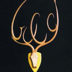 Shopping Trophies by artist Pucci de Rossi are modern versions of wall mounted animal heads within whose stylized antlers are trademarks, logos and brand names like Nike, Gucci, Coca Cola, Prada and more.