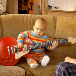 Baby rips Black Keys on electric guitar! Rocksmith viral is pretty cute.