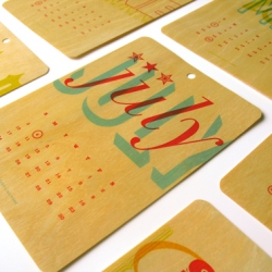 A Year in Caps: 2011 Typographic Calendar is a series of twelve sustainably-harvested birch veneer cards. Interpreted each month typographically. with US holidays.