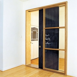 Check out this adorable sliding chalkboard door in Haus Hoffman, a retrofitted Wilhelmian townhouse in Hamburg, Germany!