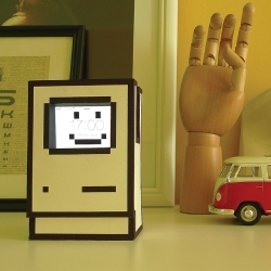 """Do it yourself project: a stand for a smartphone made of paper that looks like a vintage """"Happy Computer"""" icon. All blueprints and an assembly instructions are available"""