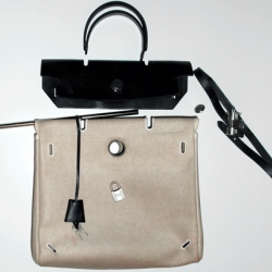 Hermes Herbags are Kelly bags crafted from rubberized canvas and bridle leather... The purses come apart, and the pieces are interchangeable so you can mix and match... See the scans of the instructions!