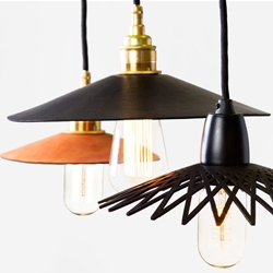 'Hide' is a range of beautiful hand-molded leather pendant lights, designed by Ben Wahrlich for AN/AESTHETIC.