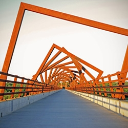 The High Trestle Trail Bridge, designed by RDG Art Studio in Iowa, has a beautiful blooming effect from the front, but a very different (and surprising) look from the side.
