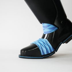 Origami Knight is a boot concept that utilizes the traditional origami technique to allow the hard surface to flex. With the rest of the boot made of molded PVC plastic, the origami sections act as the flex points as well as adding character.