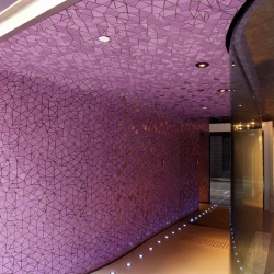 Hotel V was designed by studio OFF with an idea of roughness as a metaphor. The wall finished with a special mosaic expression tile to give different visual expressions in different weather conditions and viewing angles.