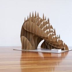 Toby Horrick's experiments in cardboard lead to sculpture that shares a common grid but unique parametric abstracts.