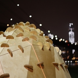Skylights: Dumbo is a sculptural pavilion that utilizes ambient lighting within Brooklyn Bridge Park to show star constellations on the ground via cast shadows, poetically addressing the side effects of light pollution in urban settings.