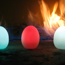 Oggz Color Morphing Eggs in front of fire.