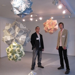 Andrew Ooi is a self taught Toronto born artist. His intent is to 'bring a new light to origami' through its practical application to modern living spaces.  Ooi is always looking for new and inventive ways to apply his unique origami.