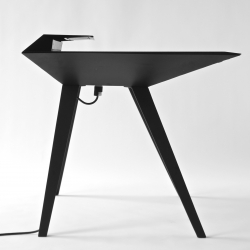 Aesthetically inspired by a stealth bomber, David Hsu's Desk 117 features a large working surface, integrated power strip and ample cable-caching space. On show at Model Citizens NYC 2012.