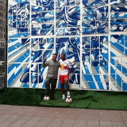 Tristan Eaton collaborates with soccer superstar and Red Bulls forward Thierry Henry on a mural. Henry shot soccer balls at targets that released triggers and actions that revealed the 24 x 21 ft mural of bulls charging.