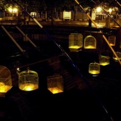 """Fishing light. 70 gold cages with light hanging over the main bridge of Maubeuge, in the North of France."
