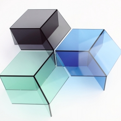 Sebastian Scherer's glass tables are design objects and pieces of art at the same time. They resemble cubistic objects and invite us to play with optical illusions.