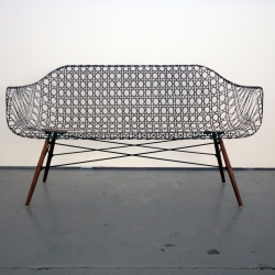 The Carbon Fiber Eames Sofa is a sofa reborn using the most modern materials and the most traditional methods.