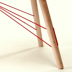 Red Rope table by Itay Laniado is a glueless tension structure, tensioned with rope and wood legs and tabletop.