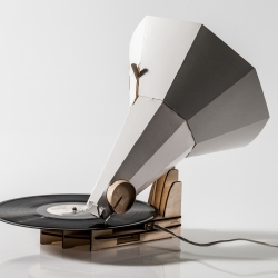 Jónófón, an acoustic vinyl-record-player that uses a papercup and a horn made out of paper to amplify the music from the vinyl record. This product comes as a flat-pack, unassembled, and is the user puts it together for himself from scratch.