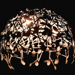 Great chandelier made from metal forks and spoons.