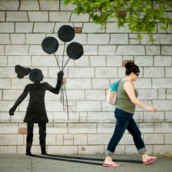 Katie Sokoler cut out human forms from black paper and taped them onto the walls and sidewalks all around Brooklyn. She then waited for people to walk by and took a picture at the exact moment they matched up with the shadow.