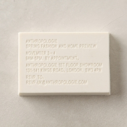 An embossed eraser invitation advertising Anthropologie's press preview event in London.