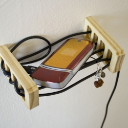 The Battery shelf gives your phone a home and provides an iconographic reminder to plug it in.  The power cord no longer needs to hide in shame; its role in keeping you connected is proudly displayed. By Brooklyn-based designer Simon Spagnoletti