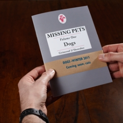 Missing Pets, volume one: Dogs. is a small book featuring a collection of missing pet posters. Published by Grimsrud & Showalter.