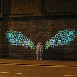 Street Projection - Elegant laser trip so when someone stands in the human outline in the middle the wings grow, animate, then they fade when the person walks away.