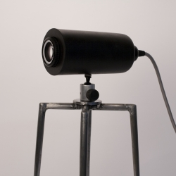The Ganglion. Interactive lamp that uses the lens from an old darkroom enlarger to control the amount of light that is let through. Ideally used as a reading light.