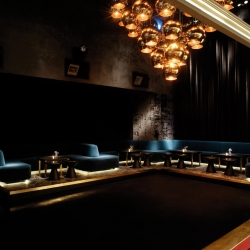 Tazmania Ballroom is an exclusive pool bar in Hong Kong's Central district. Inspiration for the plush interiors is drawn from traditional British games rooms.
