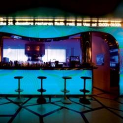 New restaurant in Belgrade, Serbia by Karim Rashid. Digital artwork made of RGB LED panels surround the bar.