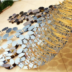 Table Cloth by Ball-Nogues Studio. A tapestry of three-legged tables decorate the front garden of the Schoenberg Music Building in UCLA campus.