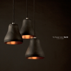 The Schwarzes Gold light by Ingo Schuppler is made from copper and charcoal and each one is crafted by hand in a delicate process.