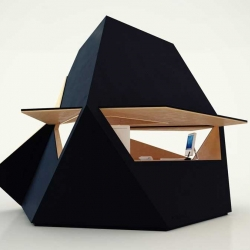 Innovation Imperative´s Tetra Shed is a space for respite (or work) that takes on the guise of a giant black rock.